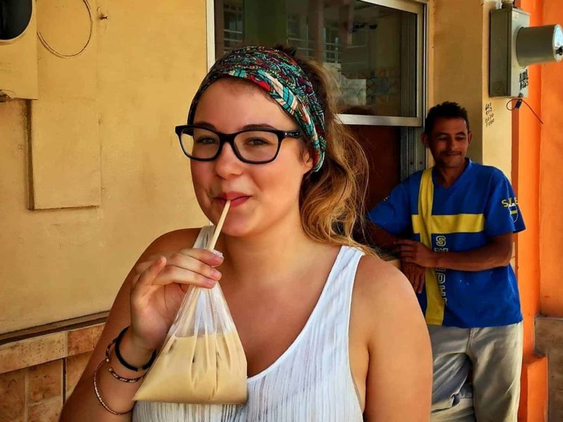 """Flo enjoying an """"horchata"""" a refreshing tasty local beverage from rice, cinnamon and sugar, served in a bag!"""
